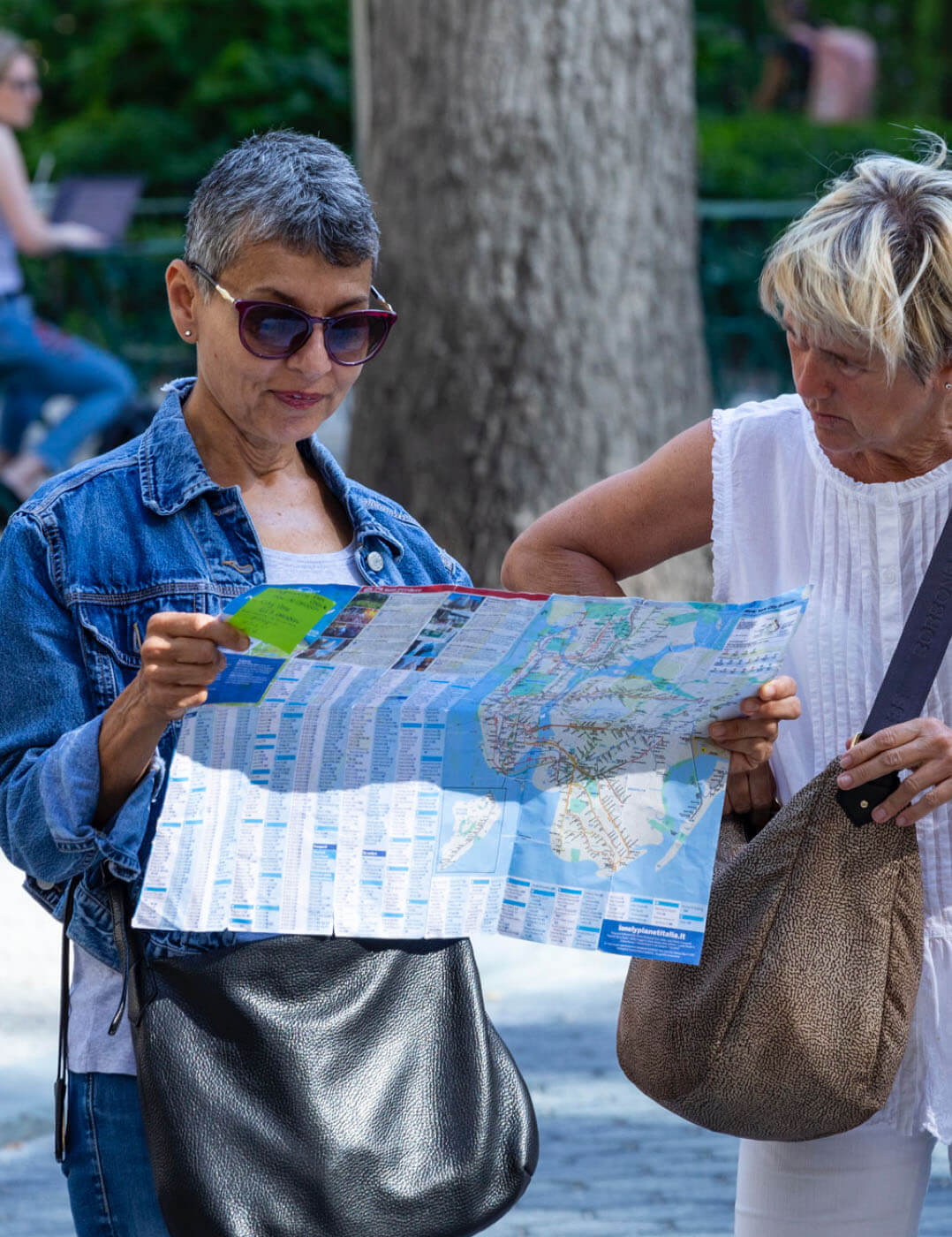 Ladies reading a map outdoors